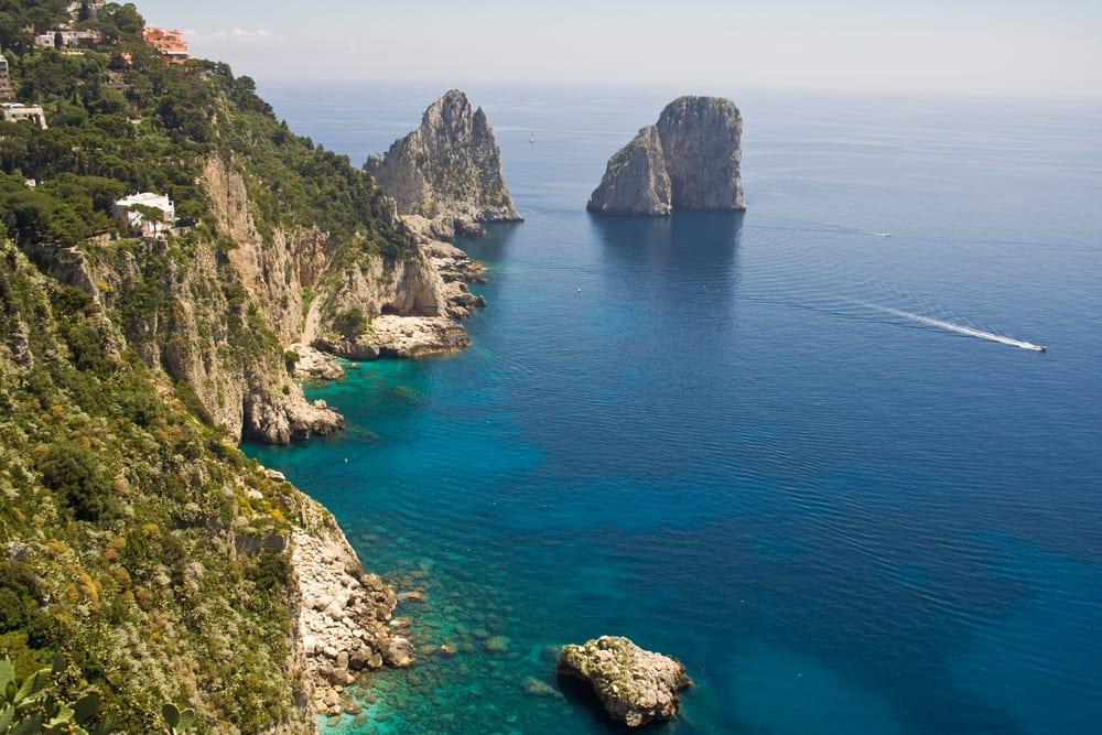 The Faraglioni in Capri (famous seaside rock formations). View of the coastline of the island of Capri, Amalfi Coast, Italy