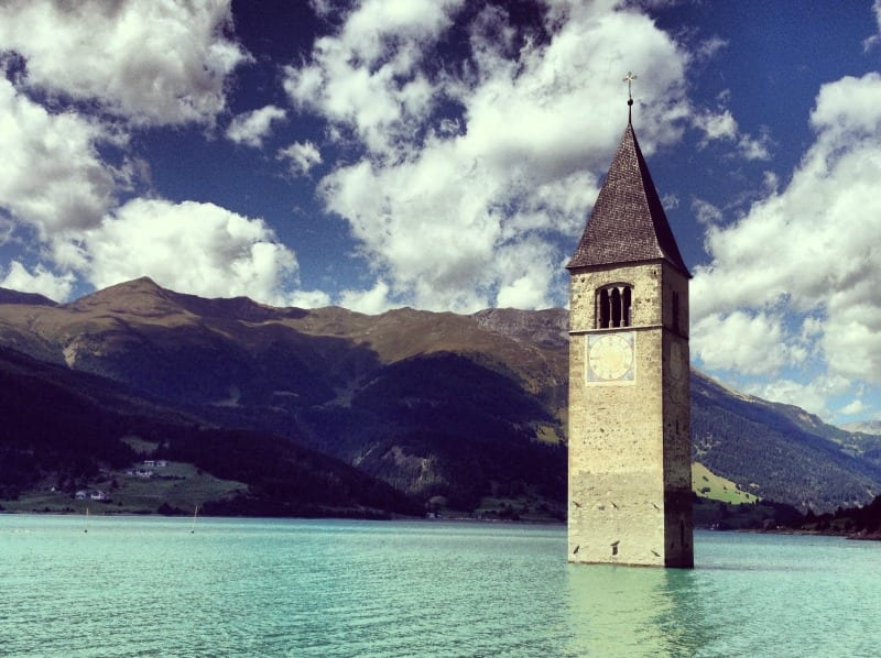 The striking church steeple on Lake Resia