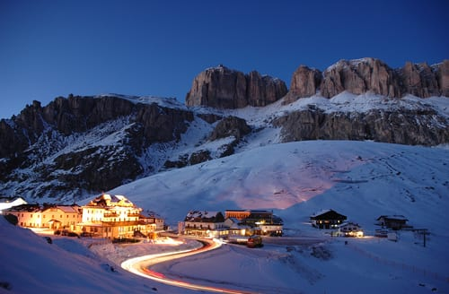 Illuminated small town in the Dolomites