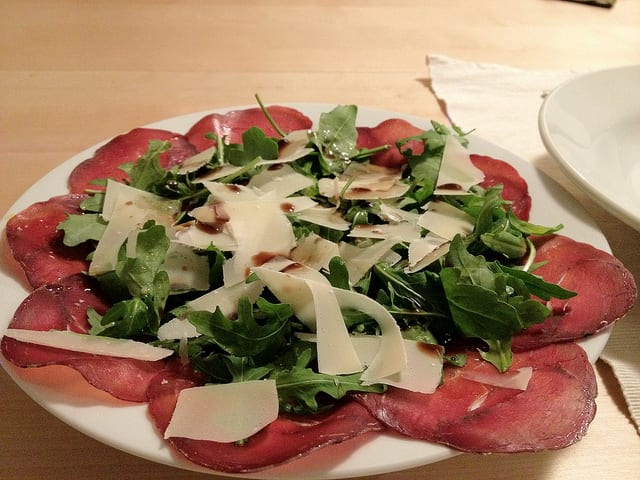 Bresaola is usually served simply. Just a bit of olive oil, grated cheese lemon, and maybe arugula, and you'll be able to enjoy the full flavors of the deli meat. Photo by Glen MacLarty